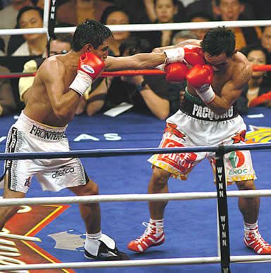 The world...I mean the whole Philippines waited in bated breath while watching pacman knocksout morales.