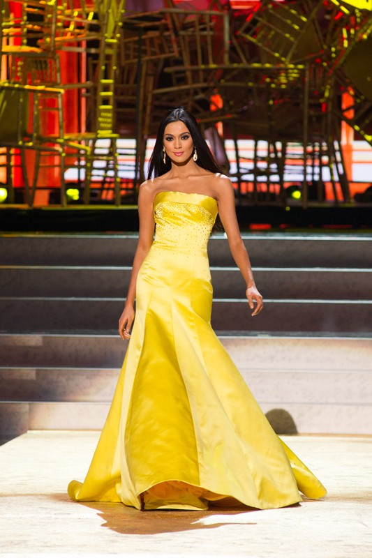 In the evening gown competition, Ariella elegantly paraded a yellow dress that finally earned her a spot in the top five.